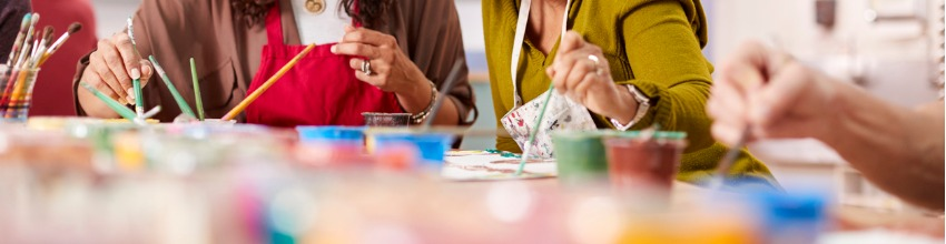picture of adults painting on a table