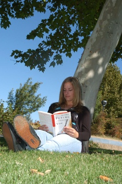 Young woman reading in the park.