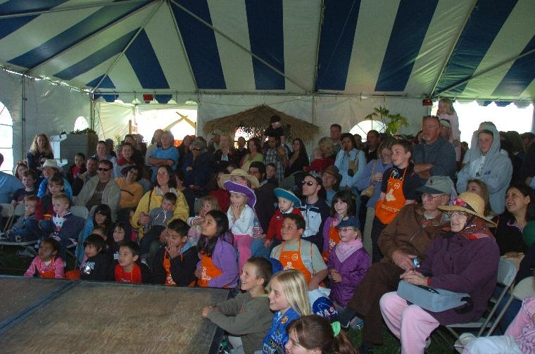 People in tent watching show
