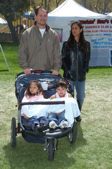 couple with kids in stroller