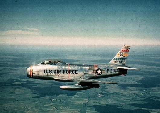 Ascani flying the F-86H Sabre; taken by Chuck Yeager at 10,000 feet over France.