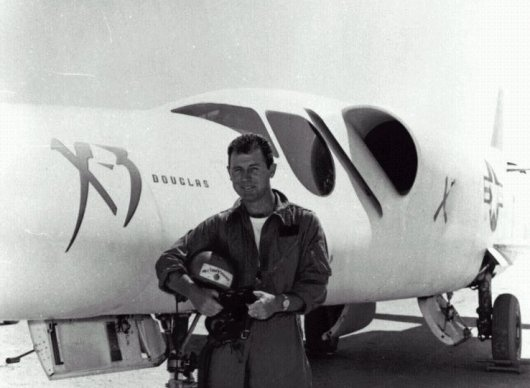 "Charles ""Chuck"" Yeager next to the powerful Douglas X-3 aricraft."